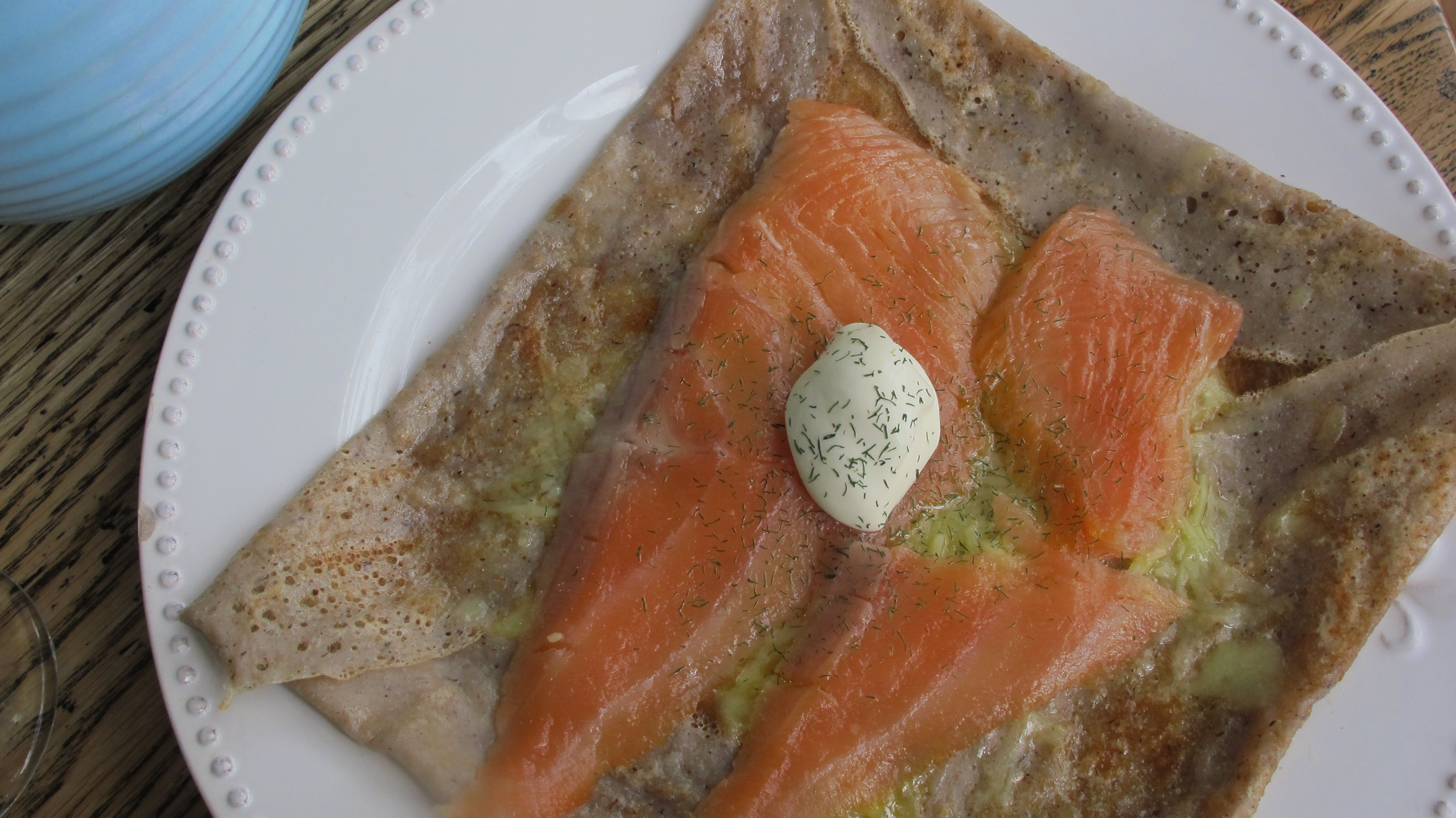 Galette with smoked salmon, cheese, creme fraiche and dill
